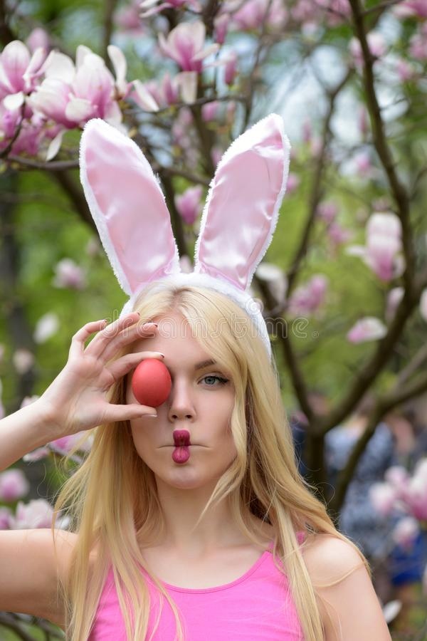 Funny girl making fish face with red egg royalty free stock images