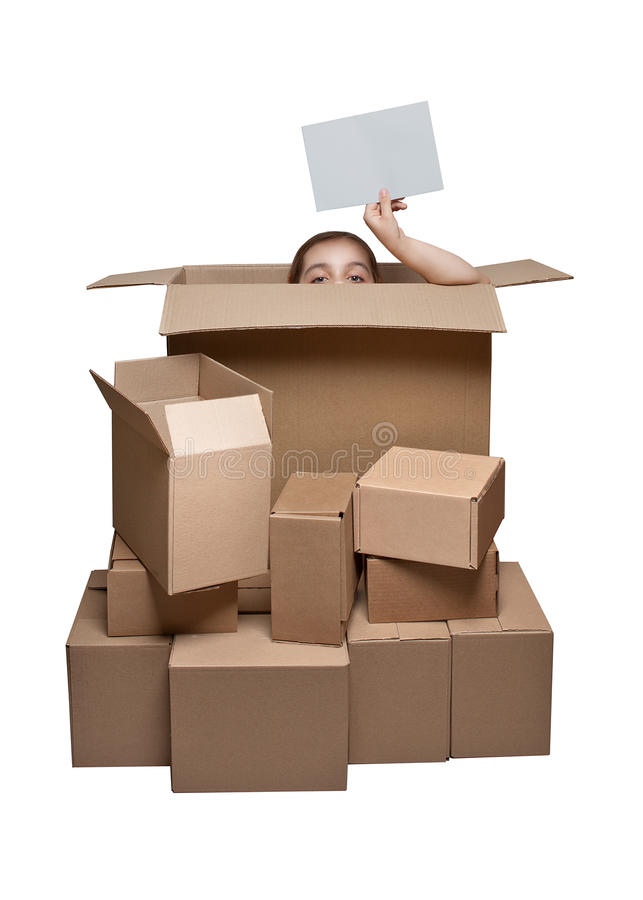 Funny girl peeking out of the box royalty free stock images