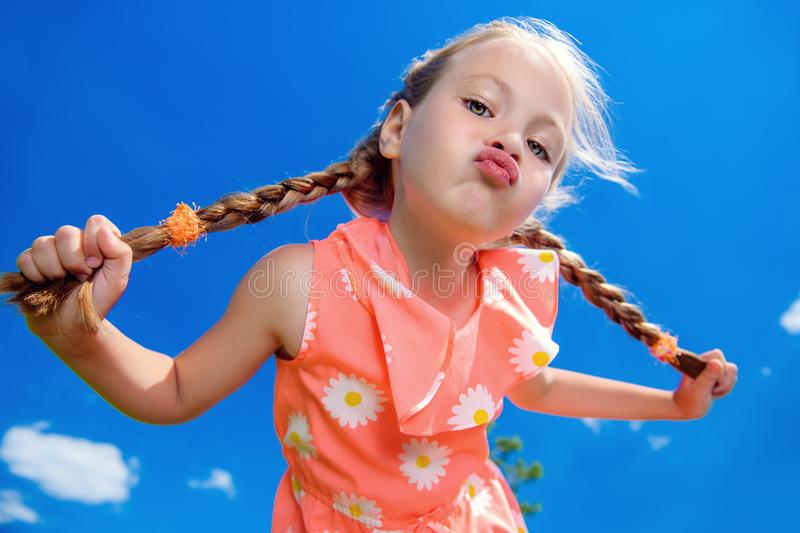 Funny girl with pigtails royalty free stock photos