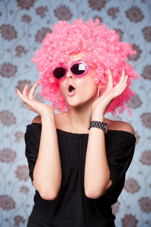 Funny girl in pink wig