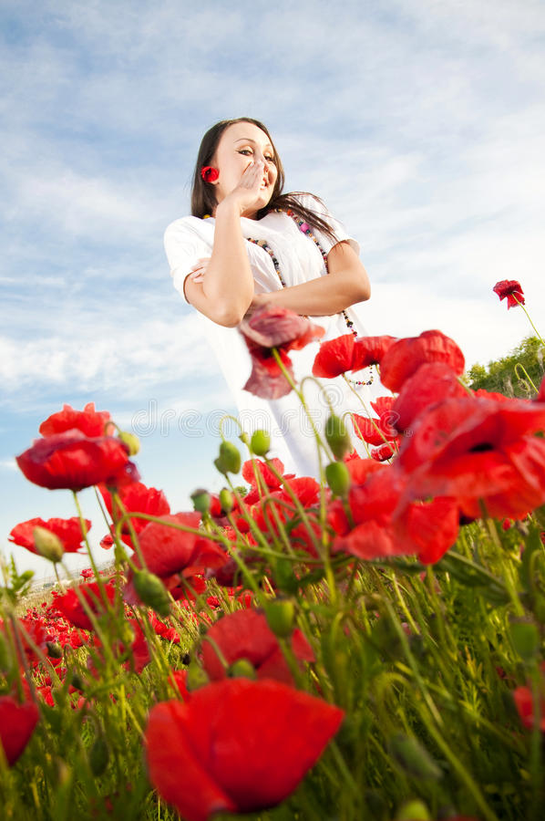 Funny girl in poppy field royalty free stock image