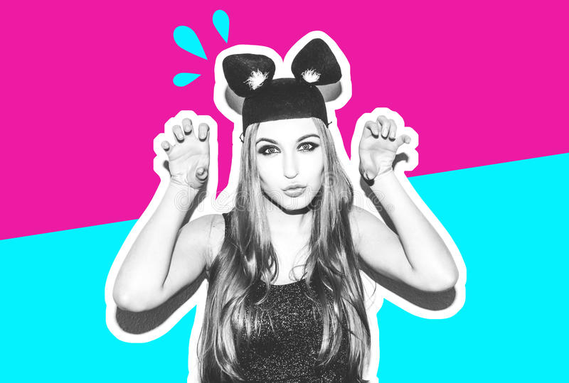 Funny girl represents a small cat or mouse. Woman with a bright makeup hairstyle and night dress mouse ears having fun royalty free stock photos