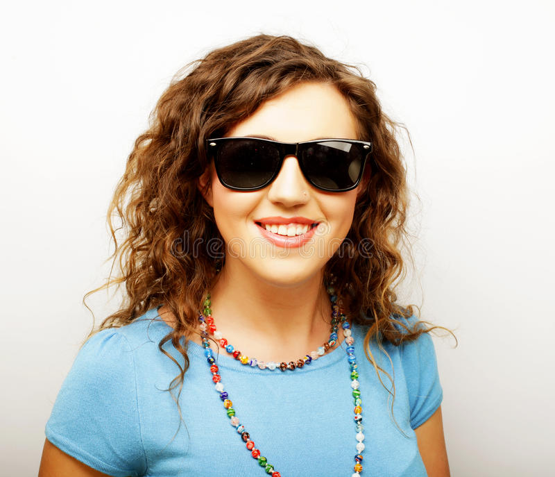Funny girl in sunglasses with expression of surprise stock images