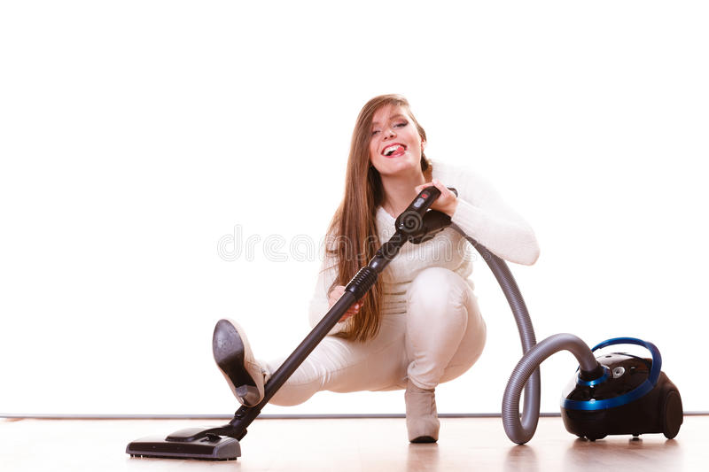 Funny girl with vacuum cleaner. Housework. Woman vacuuming the house. Funny girl with vacuum cleaner. Housework royalty free stock image
