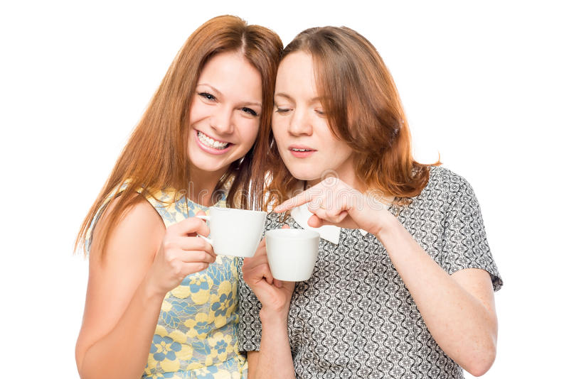 Funny girlfriends gossiping and drinking tea. On a white background royalty free stock photo