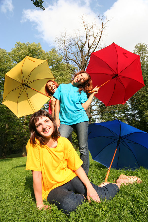 Funny girls. Funny colorful girls in park stock images