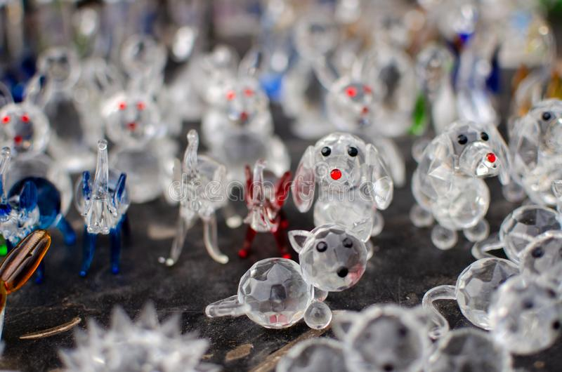 Funny glass figurines of animals for sale at Old Jaffa Flea Market. Selective focus stock images