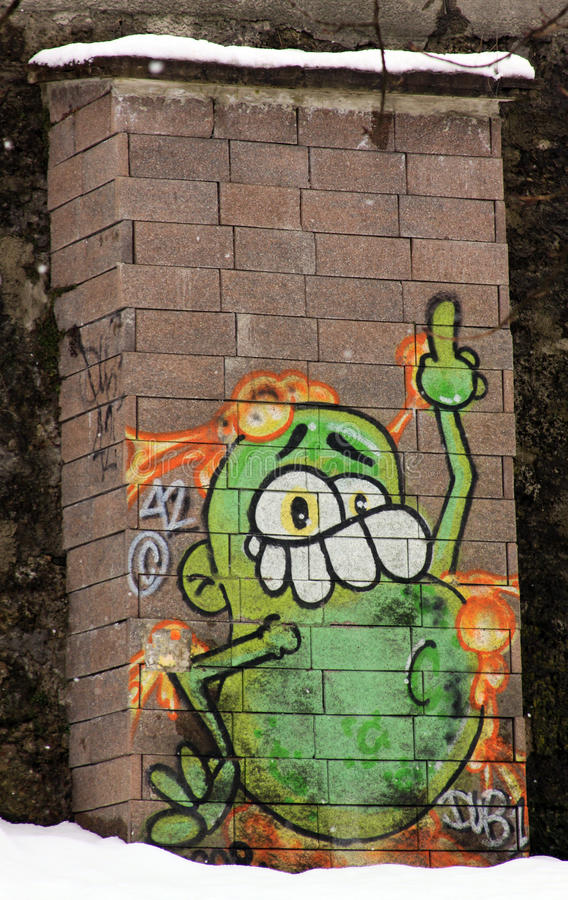 Funny graffiti on brick wall in Salzburg royalty free stock image
