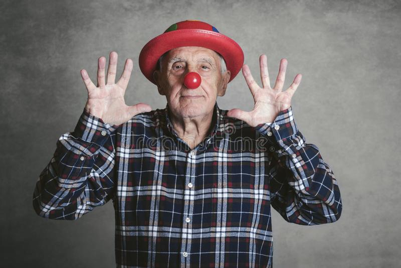 Funny grandfather with hat and clown nose stock image