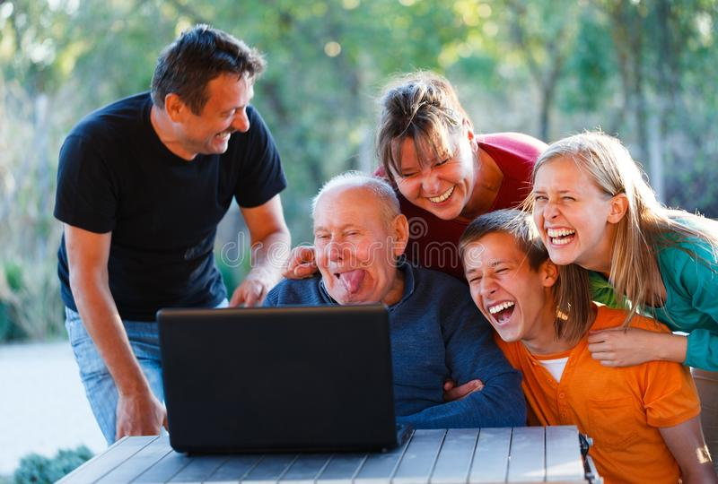 Funny grandpa. Family laughing together at the funny grandfather royalty free stock photo