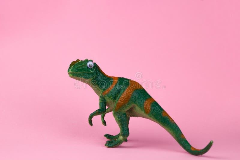 Funny green dinosaur toy stock image