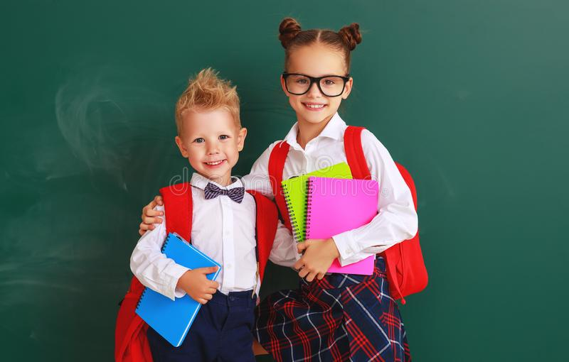 Funny group children student boy  and girl about school blackboard royalty free stock images