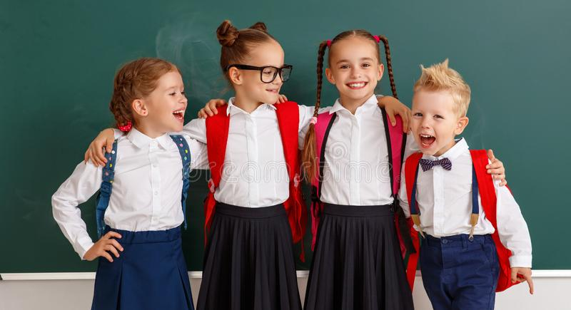 Funny group children  student boy  and girl about school blackboard. Funny happy group children   student boy  and girl about school blackboard stock photo