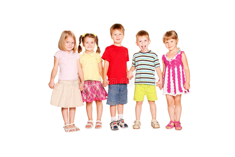 Funny group of little children holding hands stock photo