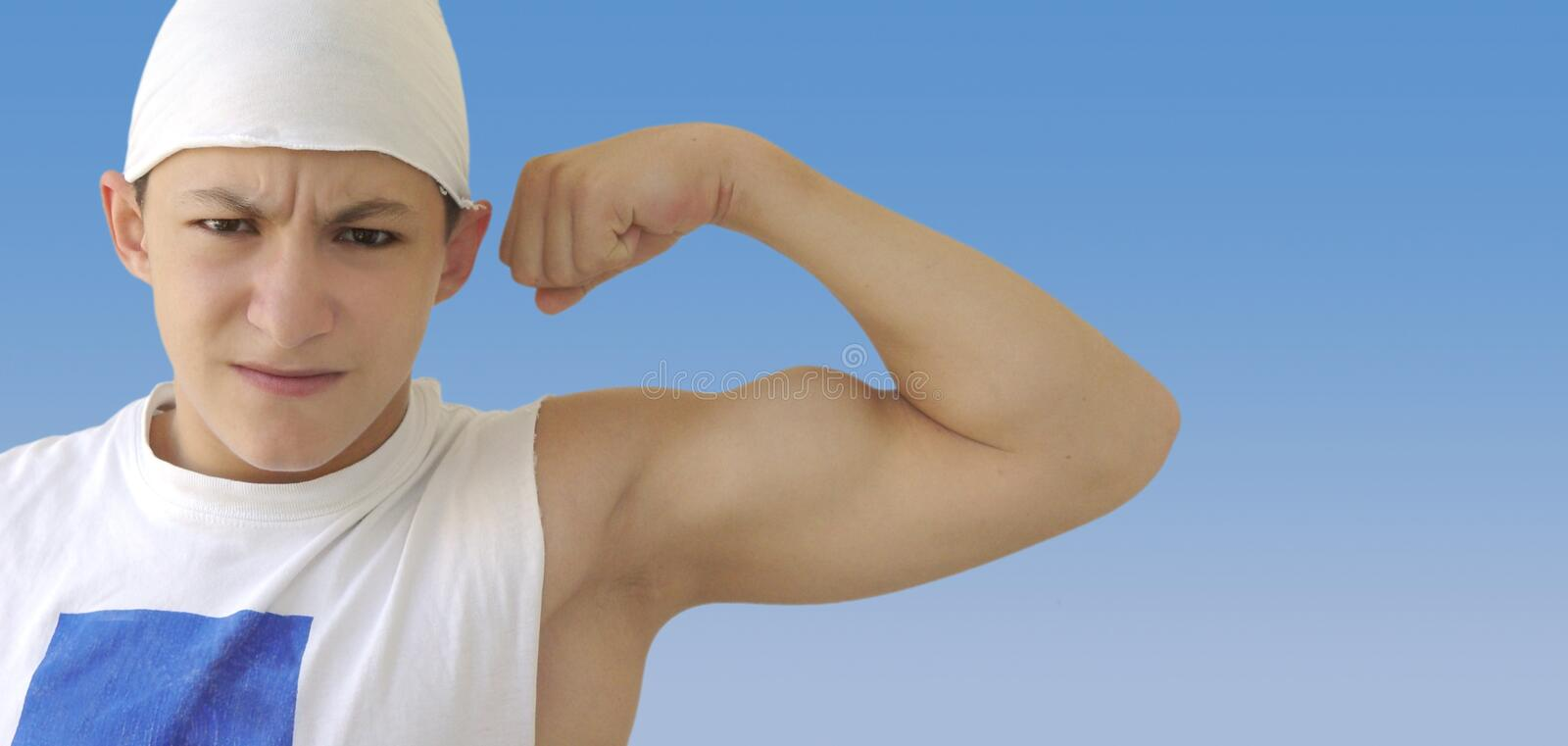 Funny guy with big muscles stock photo