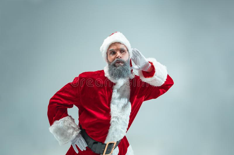 Funny guy in christmas hat. New Year Holiday. Christmas, x-mas, winter, gifts concept. royalty free stock image