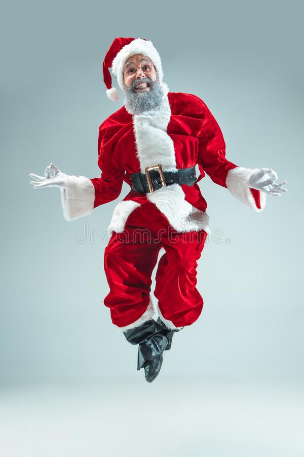 Funny guy in christmas hat. New Year Holiday. Christmas, x-mas, winter, gifts concept. royalty free stock photo