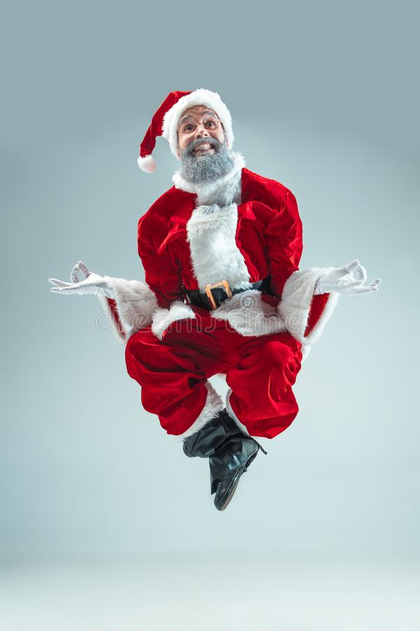 Funny guy in christmas hat. New Year Holiday. Christmas, x-mas, winter, gifts concept. stock photos