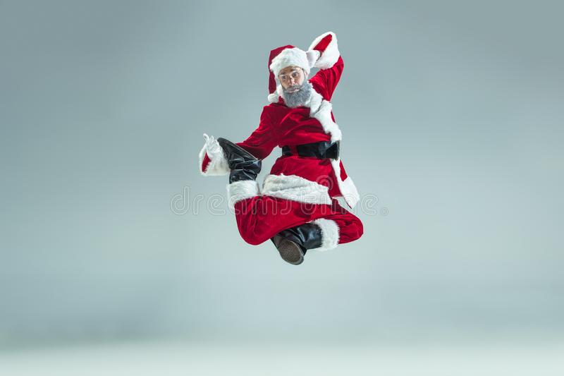 Funny guy in christmas hat. New Year Holiday. Christmas, x-mas, winter, gifts concept. stock image