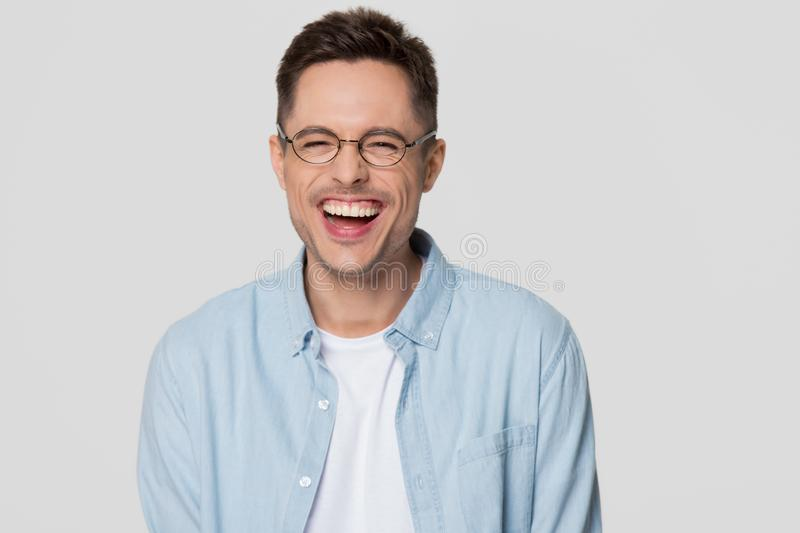 Funny guy nerd wearing glasses laughing looking at camera stock photography