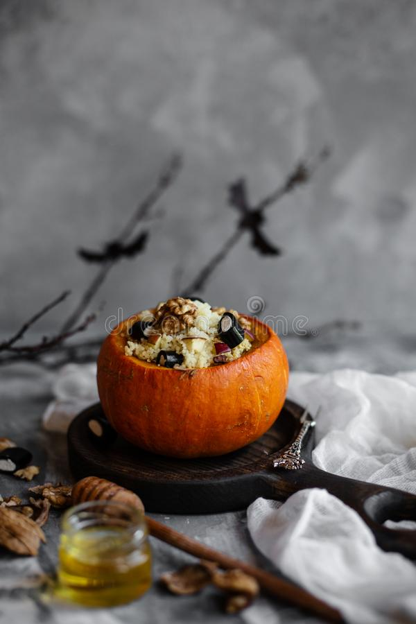 Funny halloween sweet breakfast with pumpkin, apples and honey. stock photography
