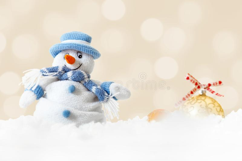 Funny blue snowman on xmas lights bokeh background, white snowflakes, merry Christmas and happy new year card concept stock images