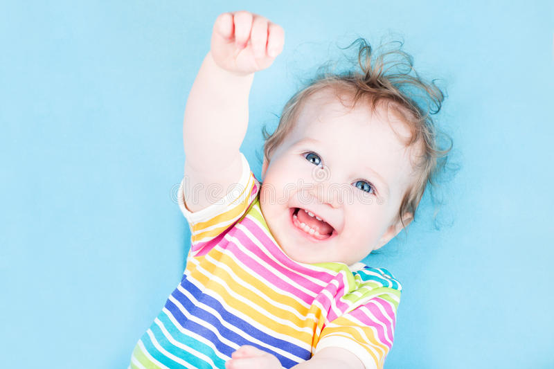 Funny Happy Baby Girl On Blue Background Stock Photo