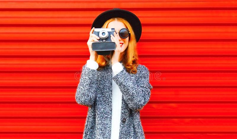 Funny happy girl with retro camera royalty free stock photography