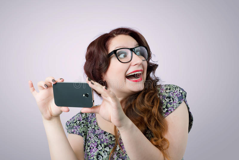 Funny happy lady with a smartphone royalty free stock photography