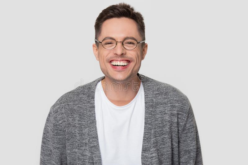 Funny happy millennial man wearing glasses laughing looking at camera royalty free stock photo