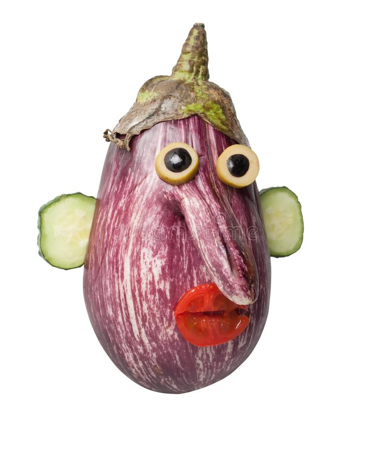Funny head made with eggplant and cucumber. Head made with eggplant, cucumber, tomato and olive. Easy way to make funny figures with simple ingridients. Shot on royalty free stock photo