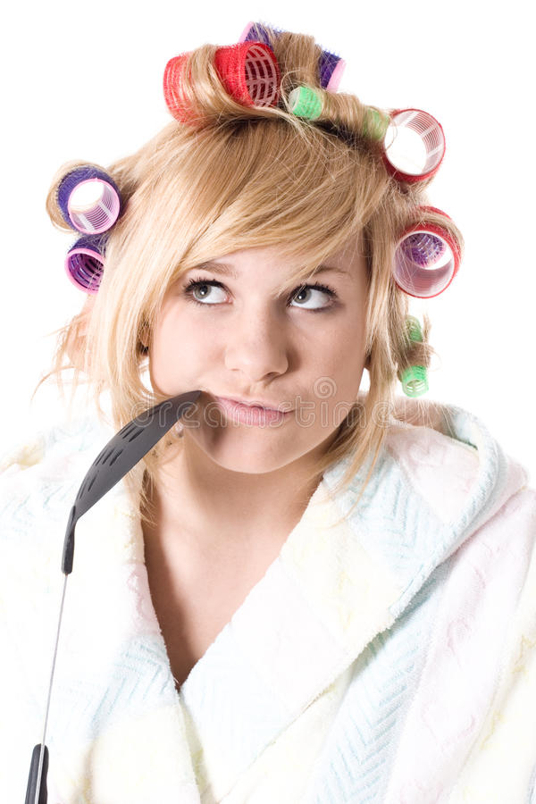 Funny housewife with curlers royalty free stock image