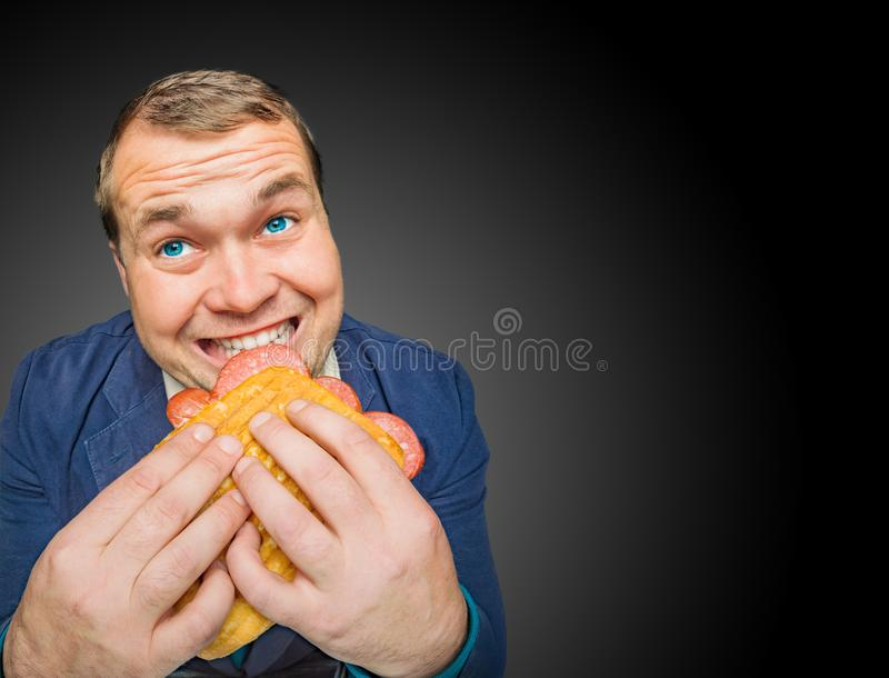 Funny hungry fat man eating the tasty sandwich stock images
