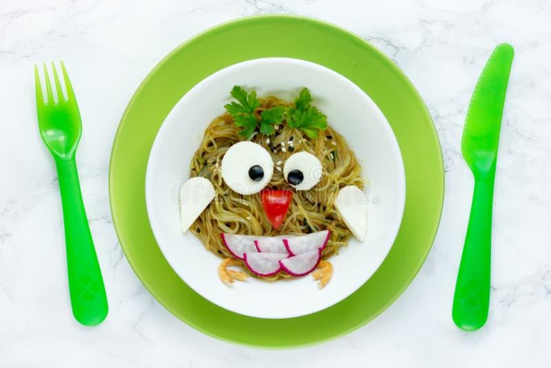Funny idea for kids meal - pasta spaghetti owl. Bird stock images