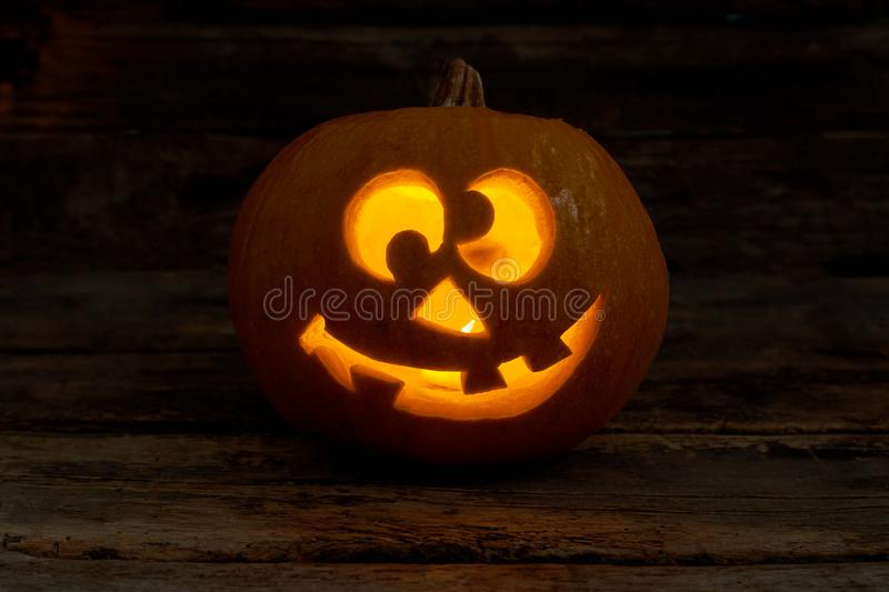 Funny Jack-O-Lantern with glowing candle. stock images