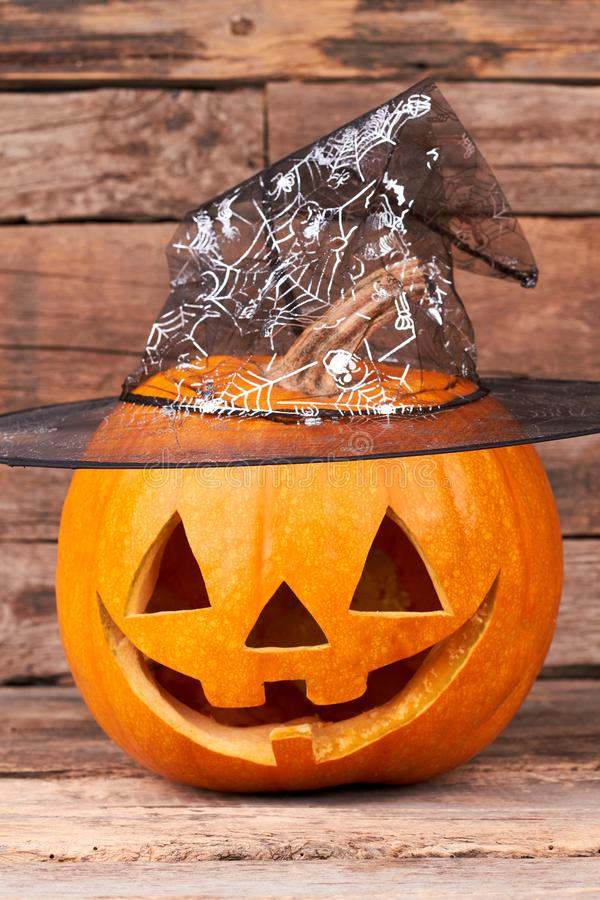 Funny Jack O Lantern on wooden background. royalty free stock images