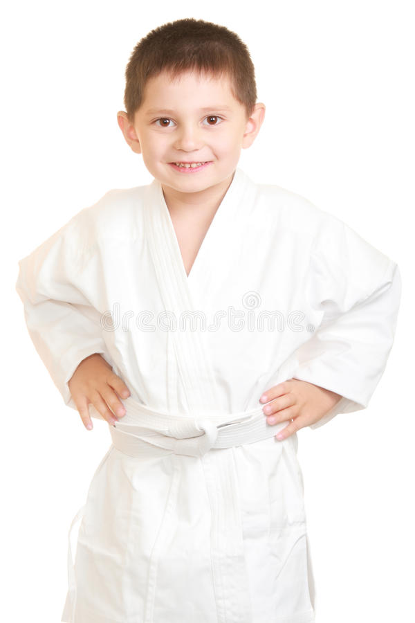 Funny Karate Kid Holding Hands On Sides Royalty Free Stock Images