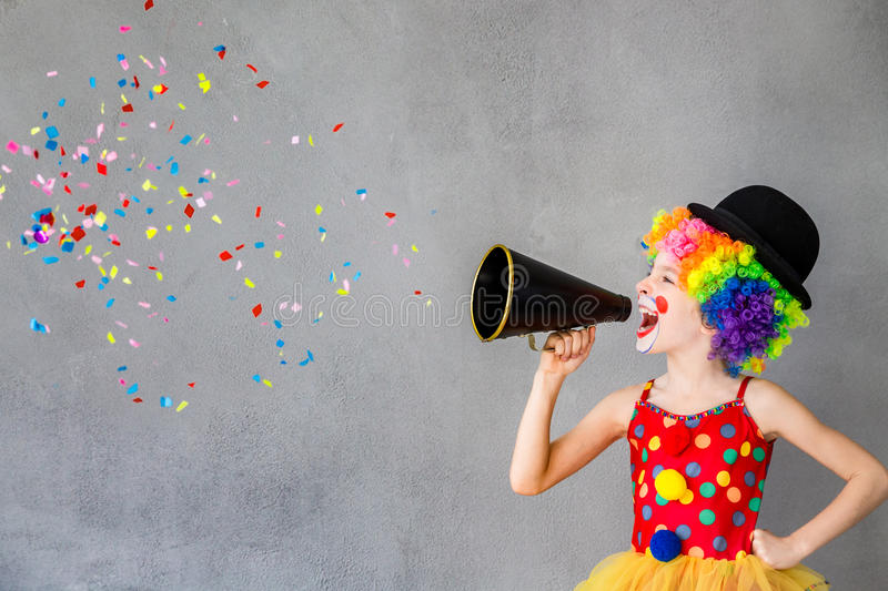 Funny kid clown playing indoor royalty free stock images