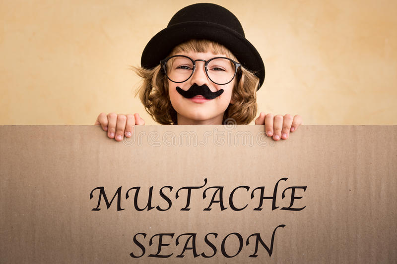 Funny kid with fake mustache. Holding banner blank stock image