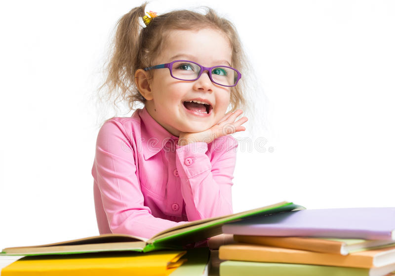 Funny kid girl in glasses reading books stock photography
