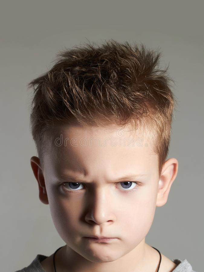 Funny kid. grimaced face of child stock photos