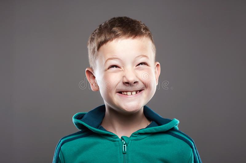 Funny kid. little boy. ugly grimace child royalty free stock images