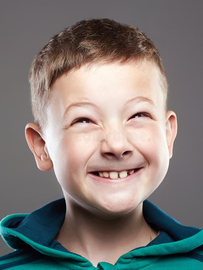 Free Funny Kid. Little Smiling Boy. Grimace Child Stock Photography - 133879362