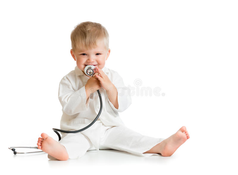 Funny kid playing doctor with stethoscope stock photos