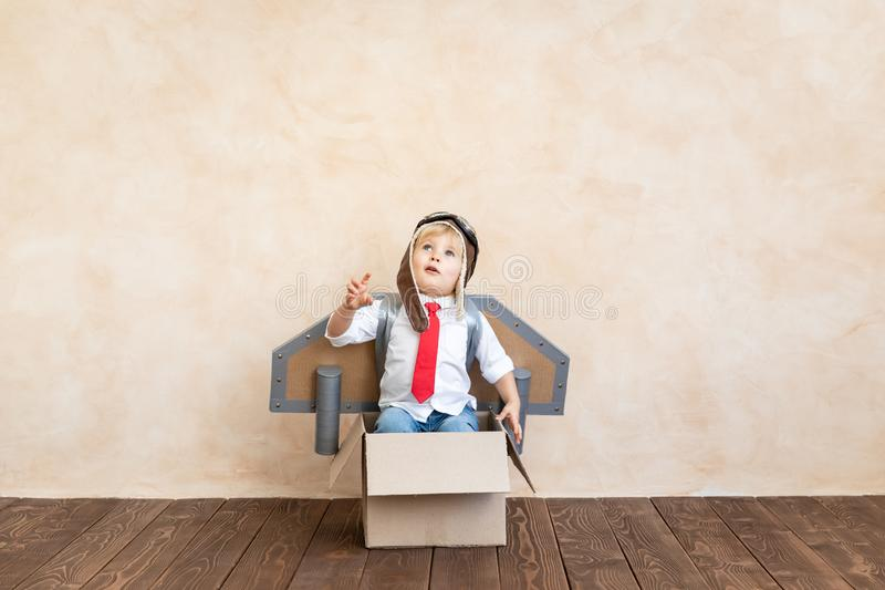 Success, imagination and innovation technology concept. Funny kid with toy jet pack. Happy child playing at home. Success, imagination and innovation technology royalty free stock photos