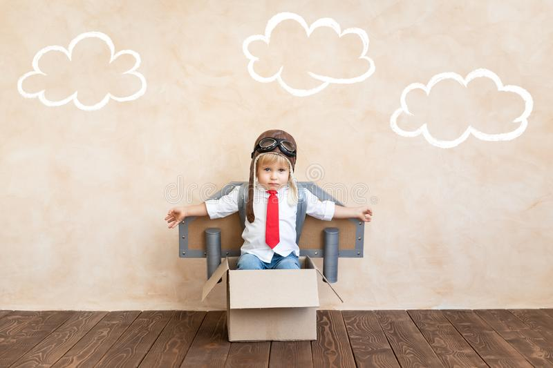 Success, imagination and innovation technology concept. Funny kid with toy jet pack. Happy child playing at home. Success, imagination and innovation technology royalty free stock images