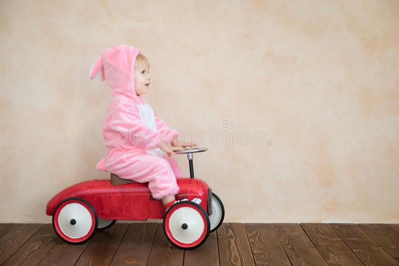 Funny kid wearing Easter bunny royalty free stock photos