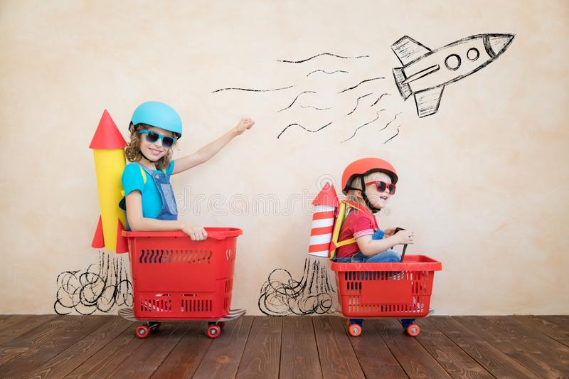 Funny kids driving toy car indoor royalty free stock images