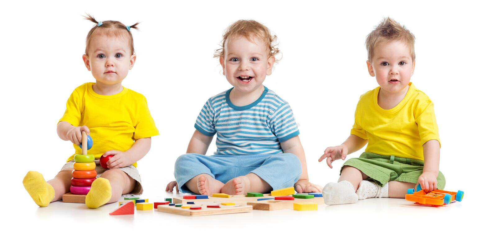 Funny kids group playing colorful toys isolated on white royalty free stock images