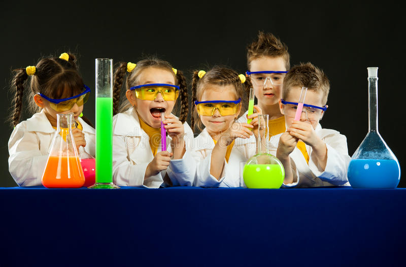 Funny kids in the laboratory. Science and education in lab. Group funny kids in the laboratory. Science and education in lab stock photos